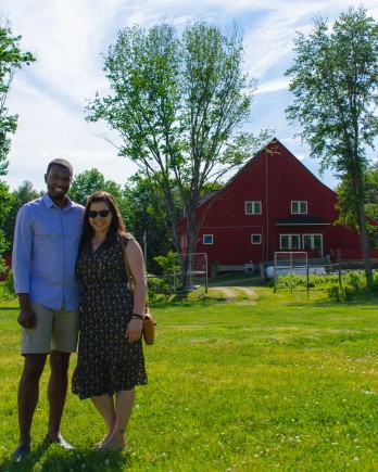 Couple photo in front of the red barn - The Farmers Dinner Generation Farm
