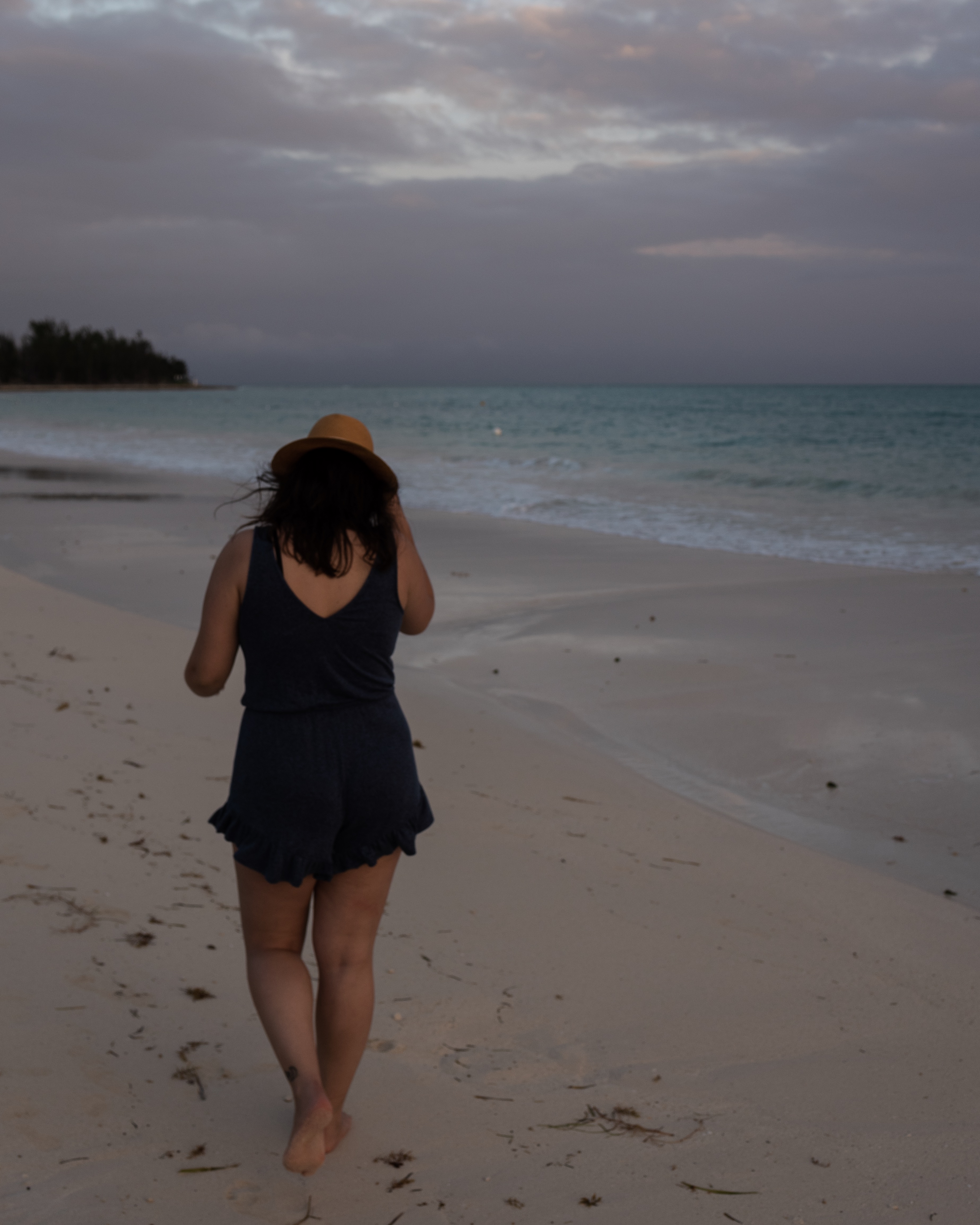 Walking the shore after sunset at Taino Beach, Freeport, Bahamas