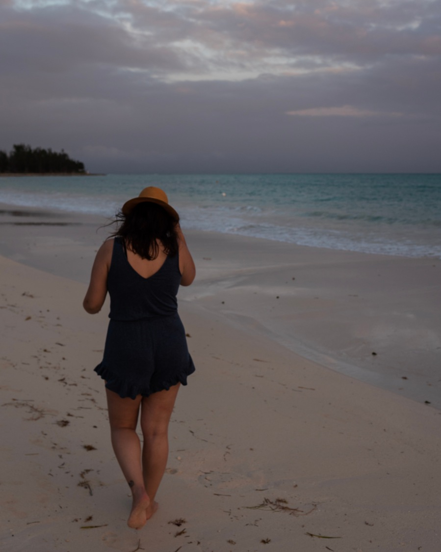 Walking the shore after sunset at Taino Beach, Freeport, Bahamas