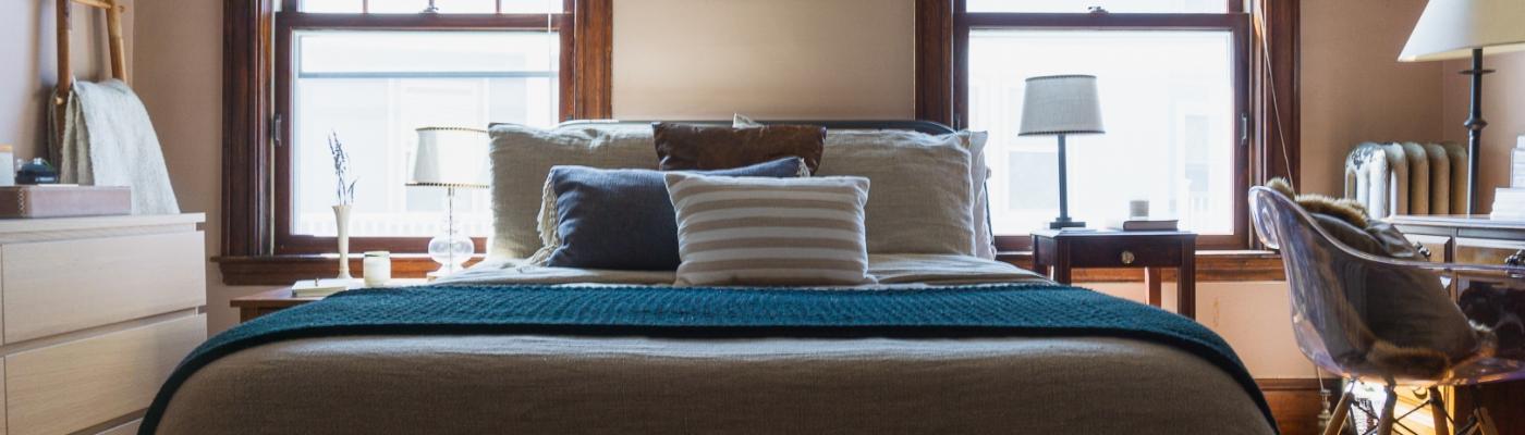 A Serine Sanctuary: Blending Styles in a Contemporary Bedroom, Zen Minimalist design, 70s boho design, neutral palette, Rental design